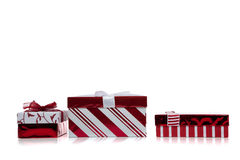 Red and white wrapped Christmas present on  white Royalty Free Stock Images