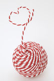 Red and white yarn in a heart Stock Image