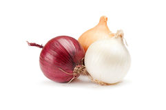 Red, white and yellow onions on a white Stock Photos