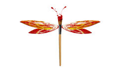 Red white yellow paint made dragonfly Royalty Free Stock Photo