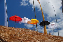 Red,white , yellow, strips beach umbrella Stock Photos