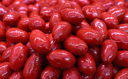 Red whole Cerignola olives in oil close up Royalty Free Stock Photo
