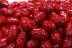 Red whole Cerignola olives in oil close up Stock Photos