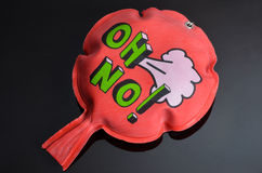 Red whoopee cushion with reflection on black glass Stock Photos
