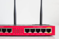 Red Wi-fi Router. Wi-fi Router Front side panel Royalty Free Stock Images