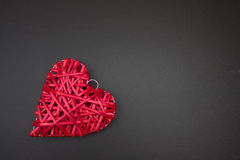 Red wicker heart on black chalk board. Valentines Day. Royalty Free Stock Photo