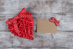 Red wicker heart and blank cardboard Stock Images
