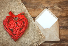 Red wicker heart with roses, ribbon, envelope stock photos