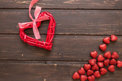 Red wicker hearts. On a brown wooden background. Valentine's Day Stock Images