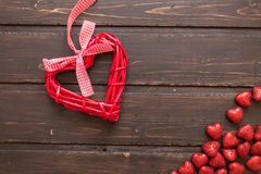 Red wicker hearts. On a brown wooden background. Valentine's Day Stock Photo