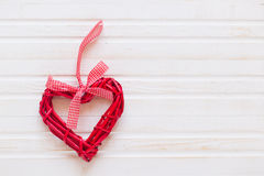 Red wicker hearts. On a white background Royalty Free Stock Photo