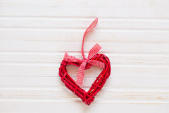 Red wicker hearts. On a white background Stock Photos