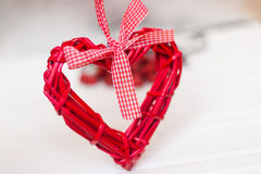 Red wicker hearts. On a white background Royalty Free Stock Photos