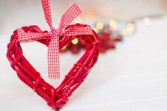 Red wicker hearts. On a white background. bokeh Stock Image