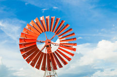 Red Wind turbine. With blue sky Royalty Free Stock Photo