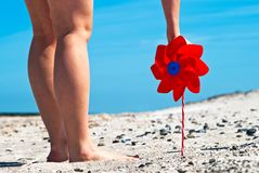 Red wind turbine on the beach Royalty Free Stock Photo