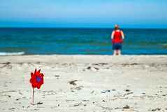 Red wind turbine on the beach Royalty Free Stock Image