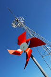 Red windmill. With the blue sky as  backgroung Royalty Free Stock Image