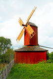 Red windmill with archaic fence. Royalty Free Stock Photography