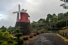 Red windmill on the coast of Pico Island Stock Images