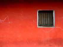 Red Window. A window on a beautiful red wall Royalty Free Stock Photo