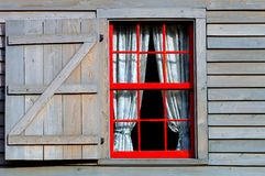 The red window. Image of red window on a old vintage house in florida Royalty Free Stock Photo