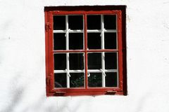 Red Window. A red window on a white concrete wall Royalty Free Stock Image
