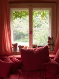 Red Window. With red sofa and curtains Stock Images
