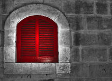 Red Window. A medieval red painted window in the old city of Mdina in Malta Royalty Free Stock Photo