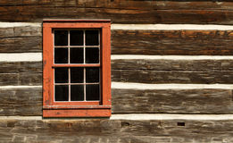 Red Window of Log Cabin. An old red window of a log cabin in Ontario, Canada Royalty Free Stock Photos