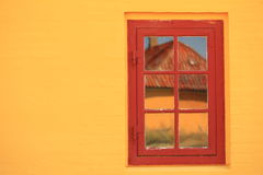 Red window on orange wall architecture detail Royalty Free Stock Images