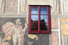 Red window of the painted building. In Cesky Krumlov town Royalty Free Stock Images