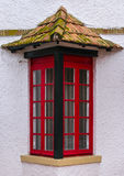 Red window with a roof Royalty Free Stock Photo
