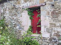 Red Window Shutter on Stone Building Royalty Free Stock Photos
