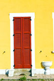 Red window  varano borghi   sunny day    wood   the concrete  br Royalty Free Stock Images