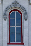 Red window on white brick wall Royalty Free Stock Image