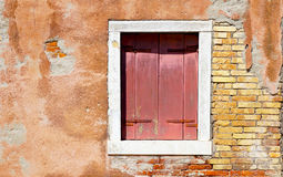 Red window in white frame and ancient decay wall Royalty Free Stock Image