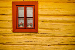 Red window, yellow wall in old house Royalty Free Stock Photography