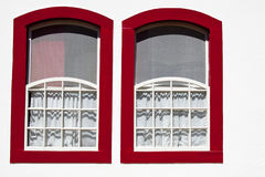 Red windows. Closeup of red window frames on a white house Royalty Free Stock Photos