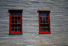 Red windows on 19th century clapboard house Stock Photography