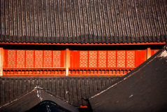 Red windows and black rooftiles stock images