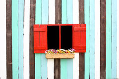 Red windows and decorative colorful wood wall Stock Photo