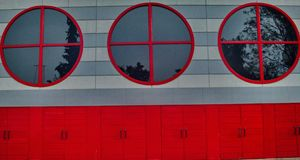 Red windows and doors. A picture of red windows and red doors,part on a building,in an International exhibition in a greek town thessaloniki Stock Photo