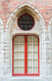 Red windows in a old stone wall Royalty Free Stock Image