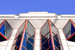Red windows. Part of an art deco building in the UK Stock Photography