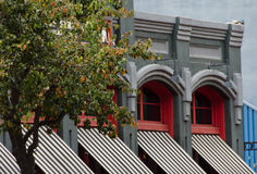 Red windows of a Victorian building in Gaslamp quarter Stock Images