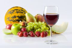 Red wine. And fresh fruits Stock Photos