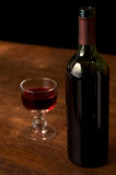 Red wine. On a wooden table Stock Images