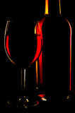 Red wine. Glass and botle of red wine in dark Royalty Free Stock Photography