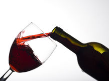 Red wine. Pouring glass of red wine Royalty Free Stock Photography